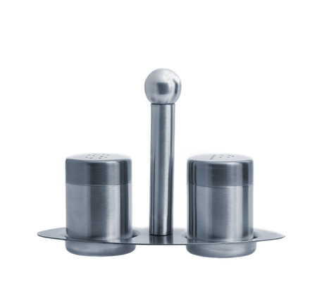Metal salt and pepper shakers on stand and isolated on white background, studio shot, two objects, front angle photo
