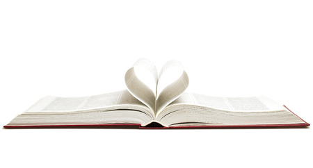 Opened book with heart isolated on white, studio shot photo