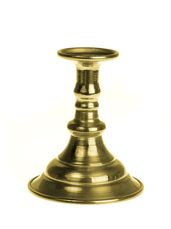 Gold plated candlestick isolated on white background photo