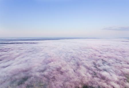 pinkish: Morning pinkish fog shot from a high altitude, sunrise, slightly toned photo Stock Photo