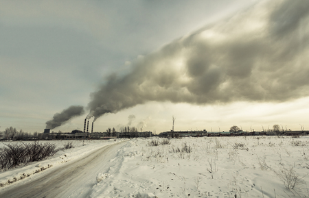 defilement: Power plant pollutes the environment, industrial pollution concept, winter shot, photo Stock Photo