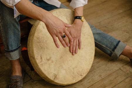 pandero: Man playing on the tambourine