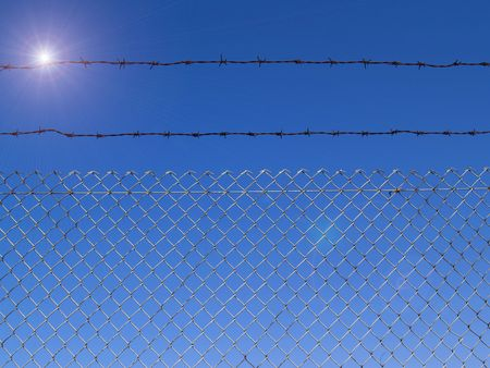 iron barred: Protect place with iron-barred and  barbed wire