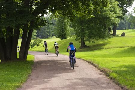 Some bicyclists on the sandy track in park