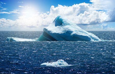 floating island: Antarctic ice island with penguins  in atlantic ocean