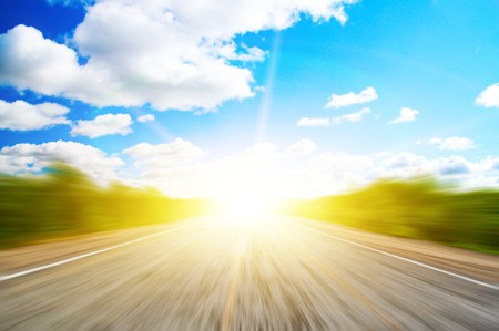 Speed road in forest to sun photo