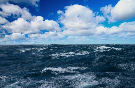 Storm sea with white horses on waves
