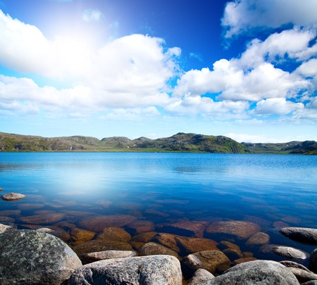 Blue lake idill under cloudline sky photo