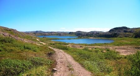 Two lakes surrounded by green hill. Coast of Kola Peninsula. Teriberka. photo