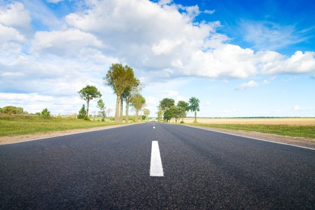 belarus: Asphalt rural road to green hills.  Belarus