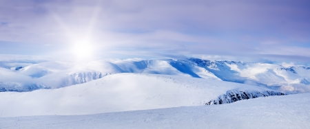 panorama view: Snowy arctic mountains in sunny day