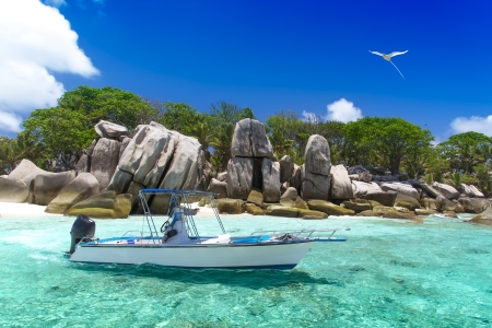 Seychelles  The island of dreams for a rest and relaxation  Azure ocean and high-speed boat  photo