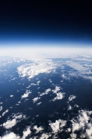 Cloudscape. Blue sky and white cloud. Sea and coastline
