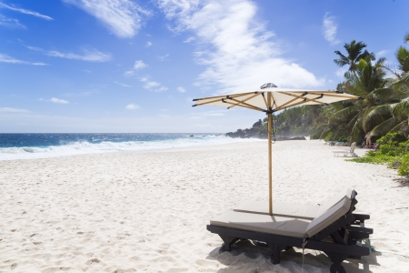 Beach chair at sunny coast. Seychelles. Mahe island. photo