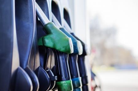 Pump nozzles at the gas station photo