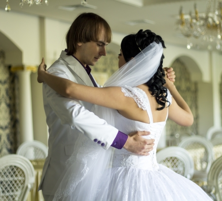 Bride and groom dancing the first dance at their wedding day Banco de Imagens - 21329256