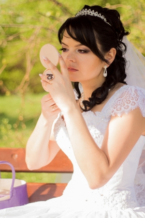 young bride is doing makeup photo