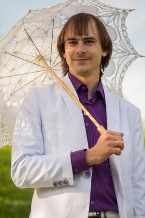 elegant man with umbrella photo
