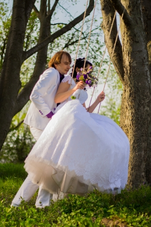 multi story: bride and groom swinging on a swing