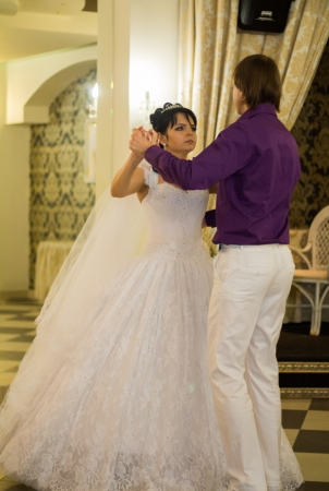 butonniere: Bride and groom dancing the first dance at their wedding day