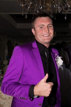 Happy man giving thumbs up sign photo