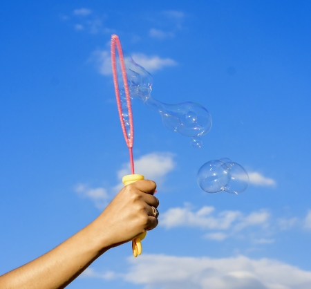 Colorful Soap Bubbles Against Blue Sky  photo