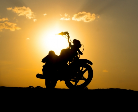Silhouette of a motorcycle of dark sky photo
