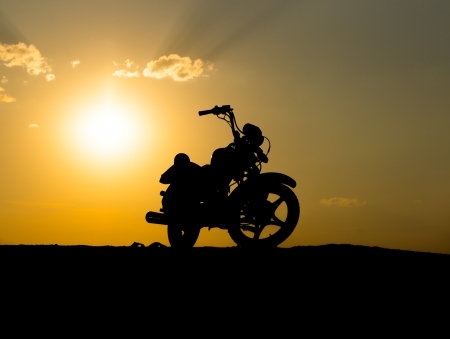 Silhouette of a motorcycle of dark sky