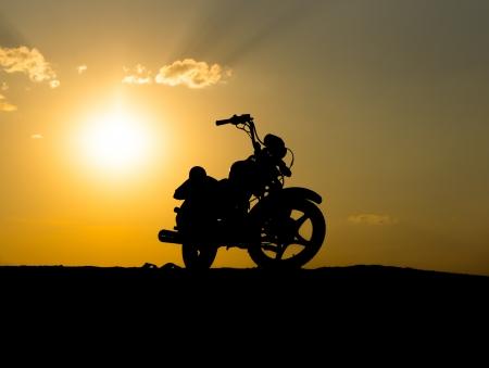 Silhouette of a motorcycle of dark sky Banco de Imagens - 22559808
