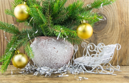 Bright christmas composition on wooden background photo