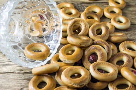 Closeup of a group of assorted bagels on a wood table top with burlap in the background photo