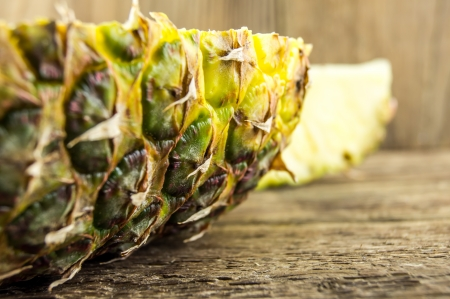 pineapple sliced ​​on a wooden background