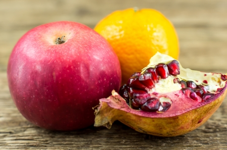 Delicious and arranged tropical fruit in the wooden background photo