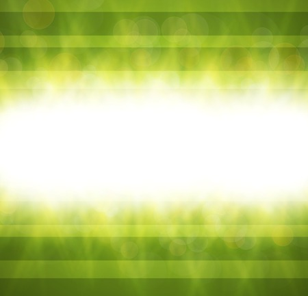overlying: Abstract green blurry background with overlying semi transparent circles, light effects and sun burst.