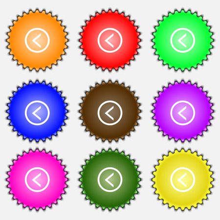 way out: Arrow left, Way out  icon sign. A set of nine different colored labels. Vector illustration