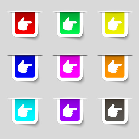 pointing hand icon sign. Set of multicolored modern labels for your design. Vector illustration Vector