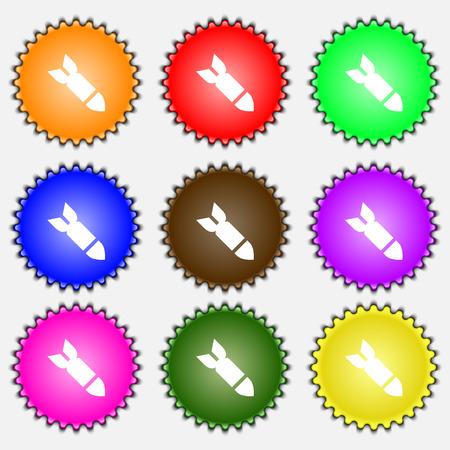 ballistic missile: Missile,Rocket weapon  icon sign. A set of nine different colored labels. Vector illustration