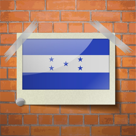 spangled: Flags of Honduras scotch taped to a red brick wall. Vector Illustration