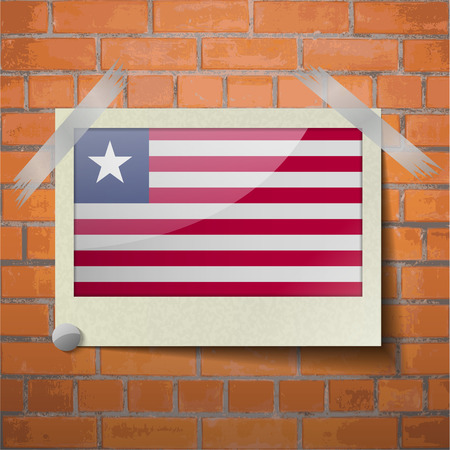 scotch: Flags of Liberia scotch taped to a red brick wall. Vector Illustration