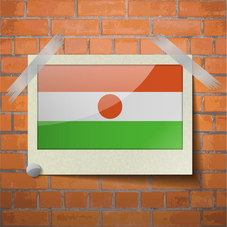 proportional: Flags of Niger scotch taped to a red brick wall. Vector
