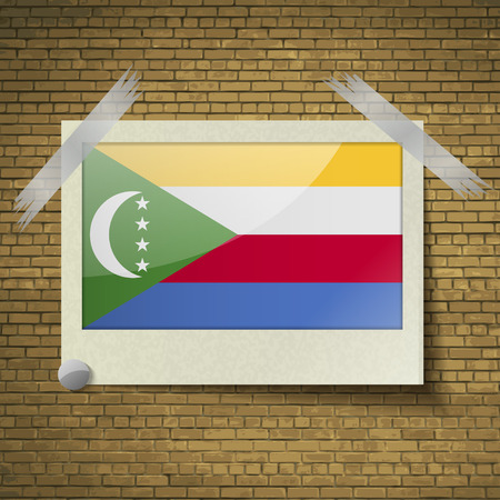 comoros: Flags of Comoros at frame on a brick background. Vector illustration