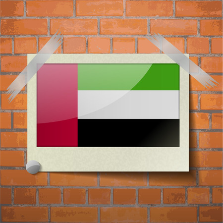 proportion: Flags of United Arab Emirates scotch taped to a red brick wall. Vector