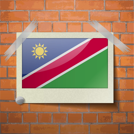flagged: Flags of Namibia scotch taped to a red brick wall. Vector