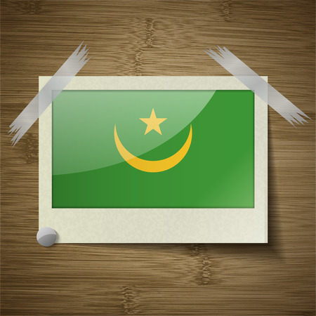 correctly: Flags of Mauritania at frame on wooden texture. Vector illustration