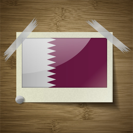 patriots: Flags of Qatar at frame on wooden texture. Vector illustration