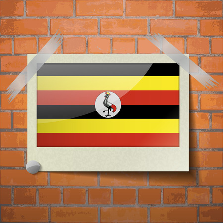 ugandan: Flags of Uganda scotch taped to a red brick wall. Vector Illustration