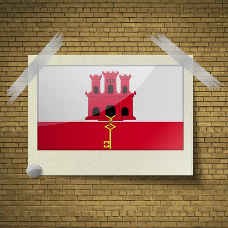 gibraltar: Flags of Gibraltar at frame on a brick background. Vector illustration Illustration