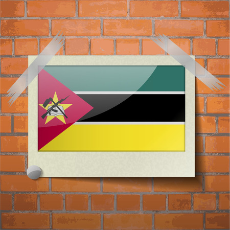 seal gun: Flags of Mozambique scotch taped to a red brick wall. Vector Illustration