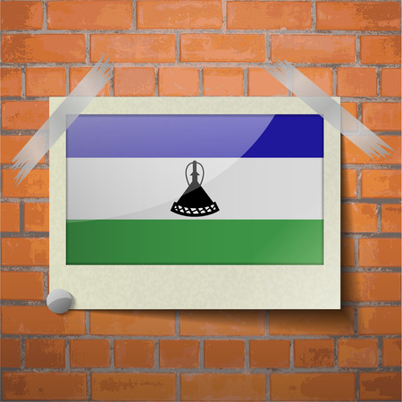 lesotho: Flags of Lesothe scotch taped to a red brick wall. Vector