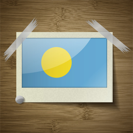 palau: Flags of Palau at frame on wooden texture. Vector illustration